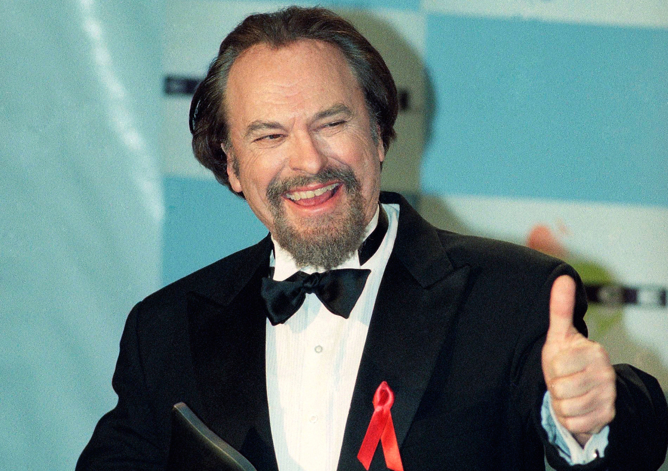 In this January 15, 1995, file photo, Rip Torn gives a thumbs-up after winning for Best Actor in a Comedy Series for HBO's