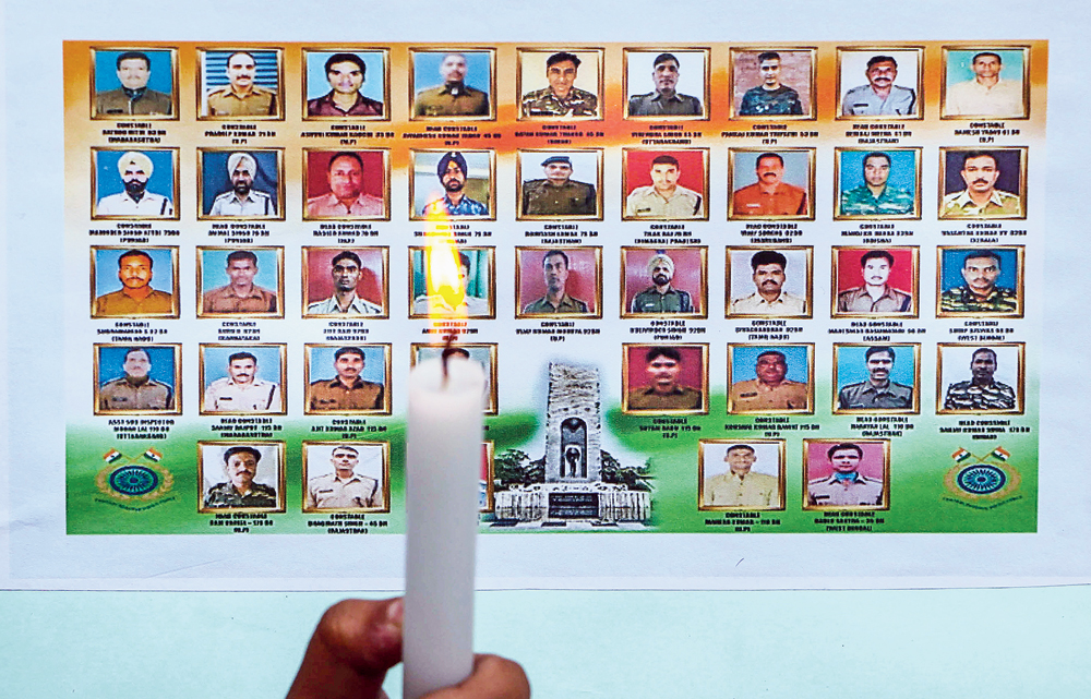 In Jammu, a candle is lit in tribute to the CRPF jawans who were killed in last year's Pulwama attack