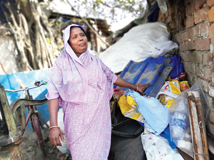 Ajmeri Khatun with her collection of waste