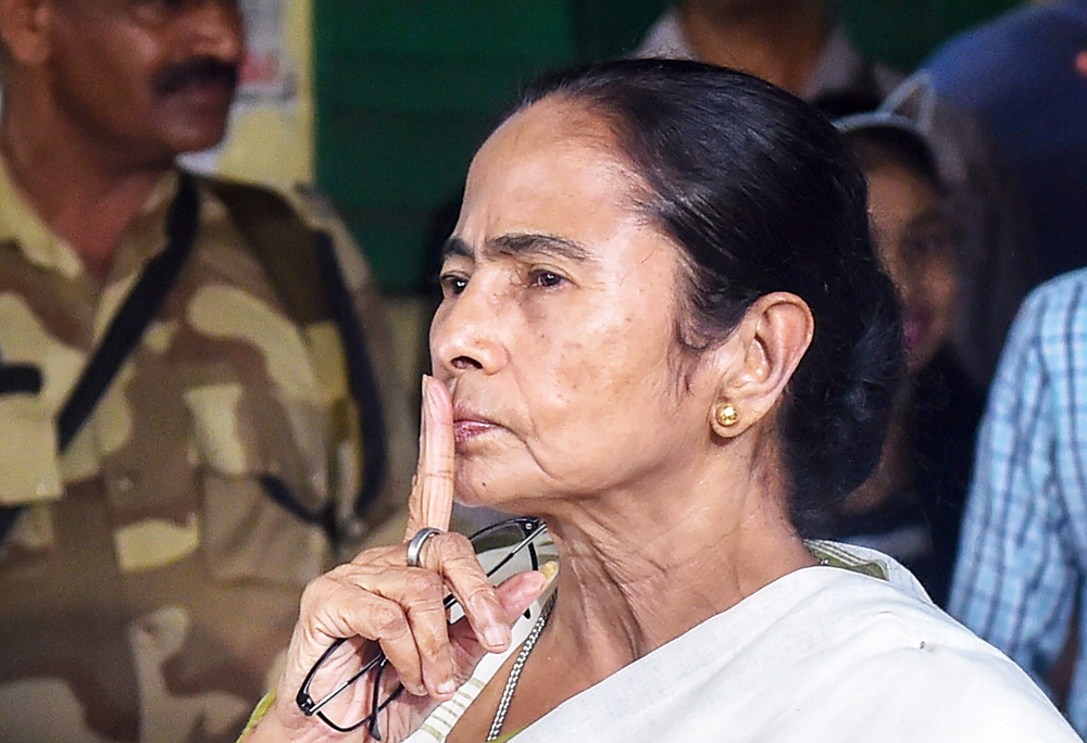 Bengal CM Mamata Banerjee gestures after casting her vote at a polling booth during the seventh and final phase of Lok Sabha polls, in Calcutta on Sunday, May 19, 2019.