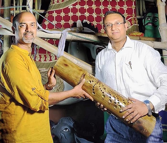 Ballygunge Cultural Association organising secretary Saptarshi Basu hands over a bamboo artefact to Amit Guha of London Sharad Utsav last week