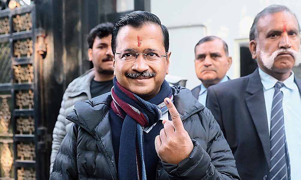 Chief minister Arvind Kejriwal shows his inked finger after voting on Saturday.