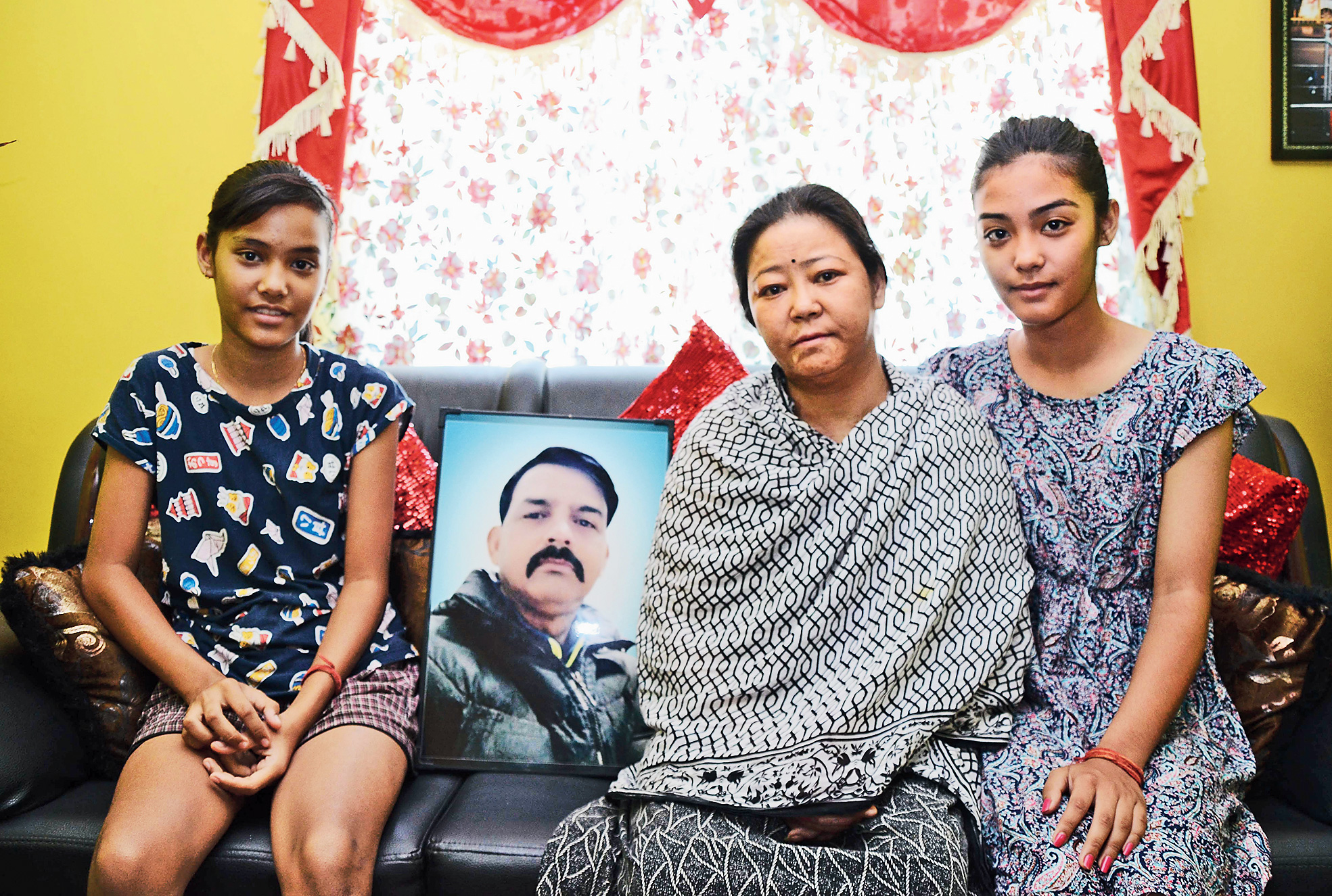 Tragic reminder: The family of JAP jawan Arvind Khetri, who lost his life to spurious liquor in September last year, at Doranda in Ranchi last week.