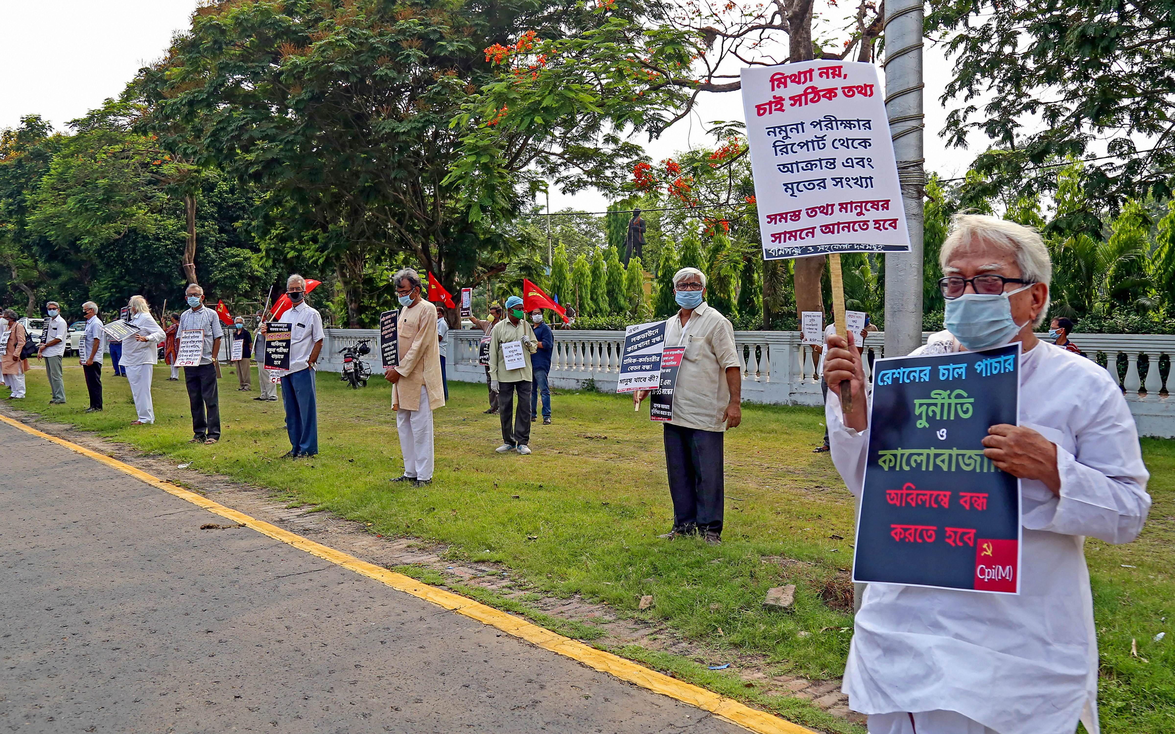 Left Front Chairman Biman Bose with other left leaders participates in a protest against the lack of COVID-19 testing in West Bengal and irregularities in ration distribution, in Calcutta