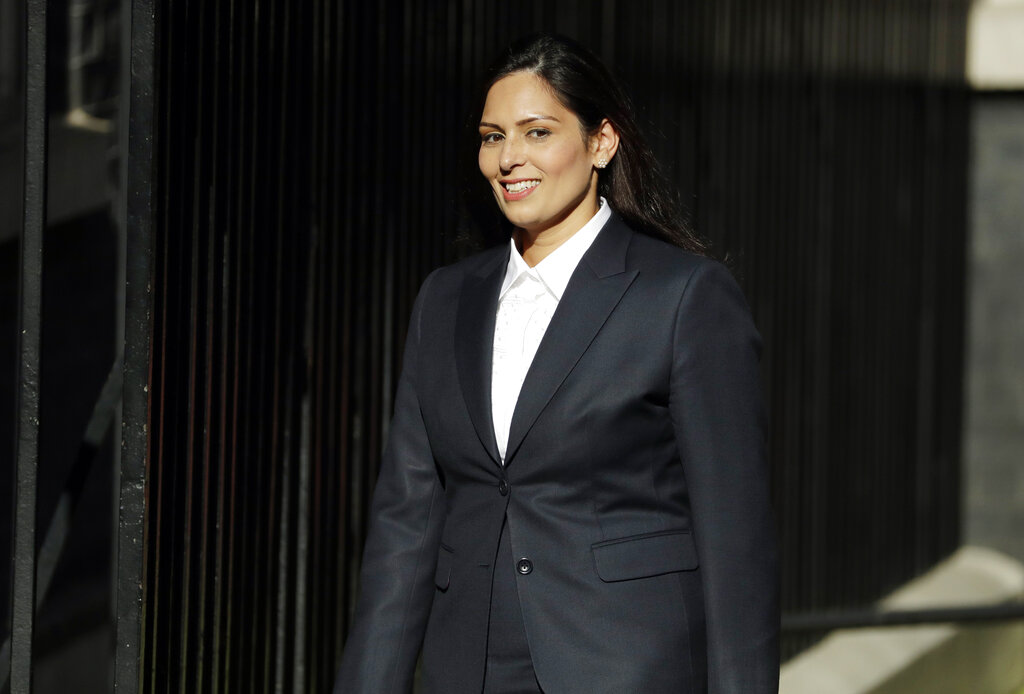 Conservative lawmaker Priti Patel arrives at 10 Downing Street, London, Wednesday, July 24, 2019