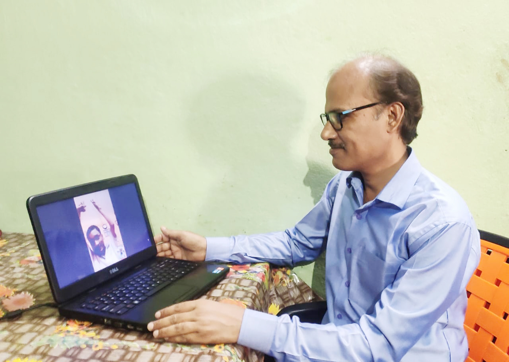 Physiotherapist, Dr. Manoj Singh interact with Avinash Kumar, a Sudamdih resident, in Dhanbad during the online training session from his home in Jharia, Dhanbad today