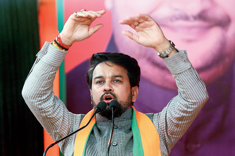 """From the crowd to the dais, the hate chant made a quick jump. On Monday, Union minister Anurag Thakur addressed an election meeting in Delhi where he chanted: """"Desh ke gaddaron ko..."""" and told the crowd to complete the slogan, which it did. Thakur repeated the slogan several times, egging on the crowd to chant louder to make themselves heard"""