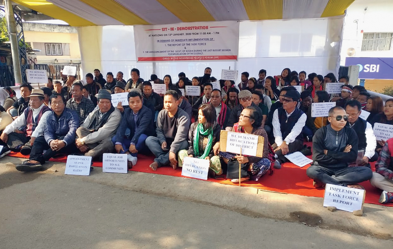 Activists stage a demonstration in Haflong on Monday.