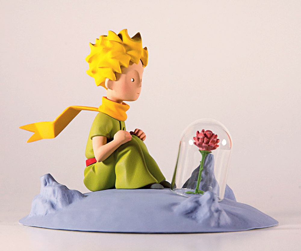 A sculpture of the little prince and the rose