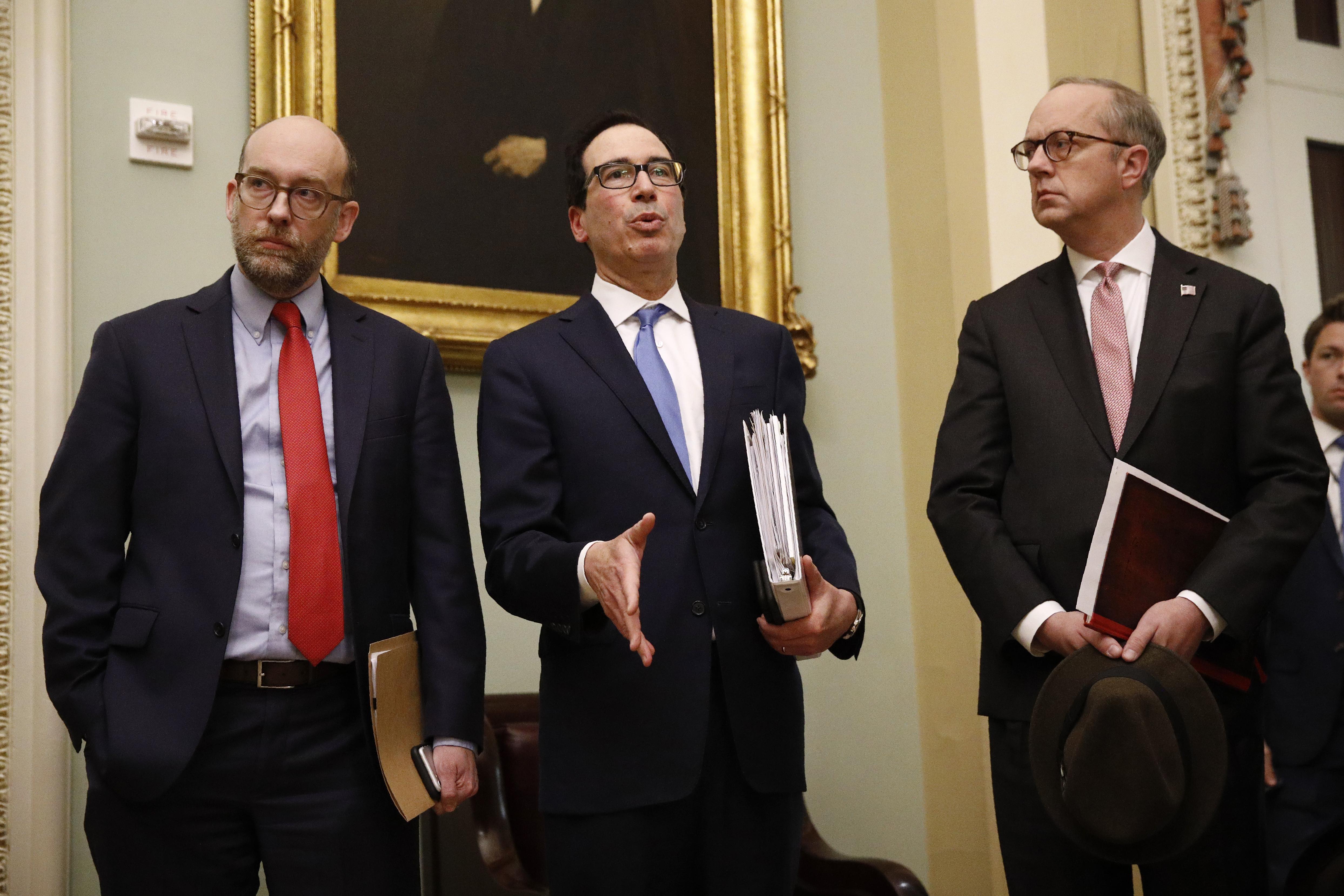 Treasury Secretary Steve Mnuchin (centre) speaks with the media on Capitol Hill in Washington.