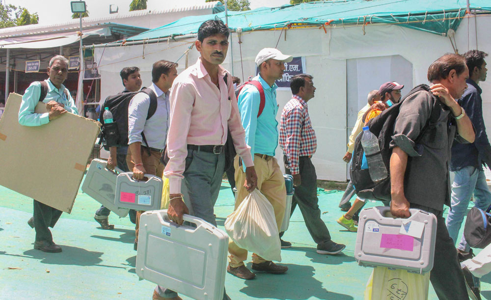 Election officials leave after collecting VVPAT machines, EVMs, and other polling material from collection centres ahead of the sixth phase of Lok Sabha polls in Bhopal on Saturday