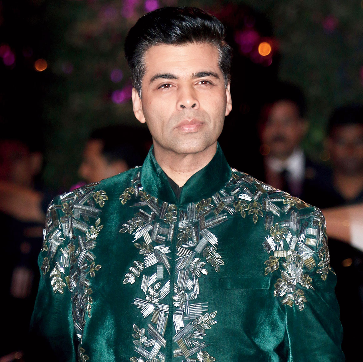 Karan Johar looooves clothes that are making a statement. He likes colours, heavy shoes and he enjoys himself! I feel he is the only director who kind of manages that style and flamboyance