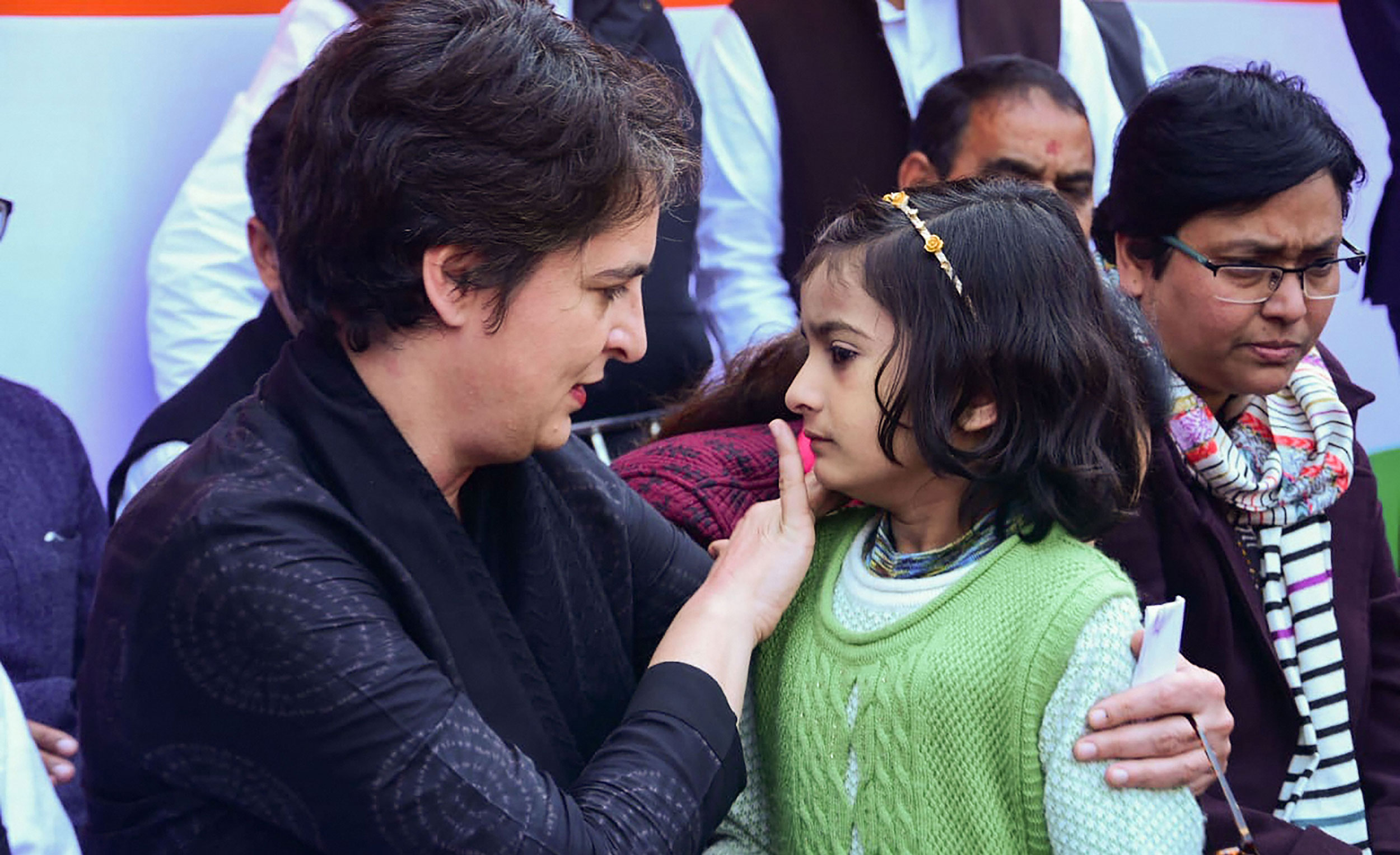 Priyanka Gandhi Vadra interacts with a girl while meeting with women who have been agitating against the Citizenship Amendment Act and National Register of Citizens (NRC), at Bilariyaganj in Azamgarh.