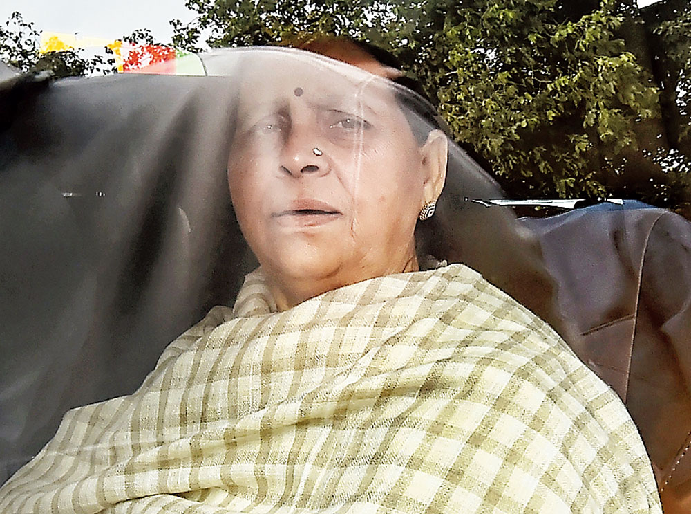 Rabri Devi leaves the Patiala House courts after appearing in the land-for-hotels scam case on Monday.
