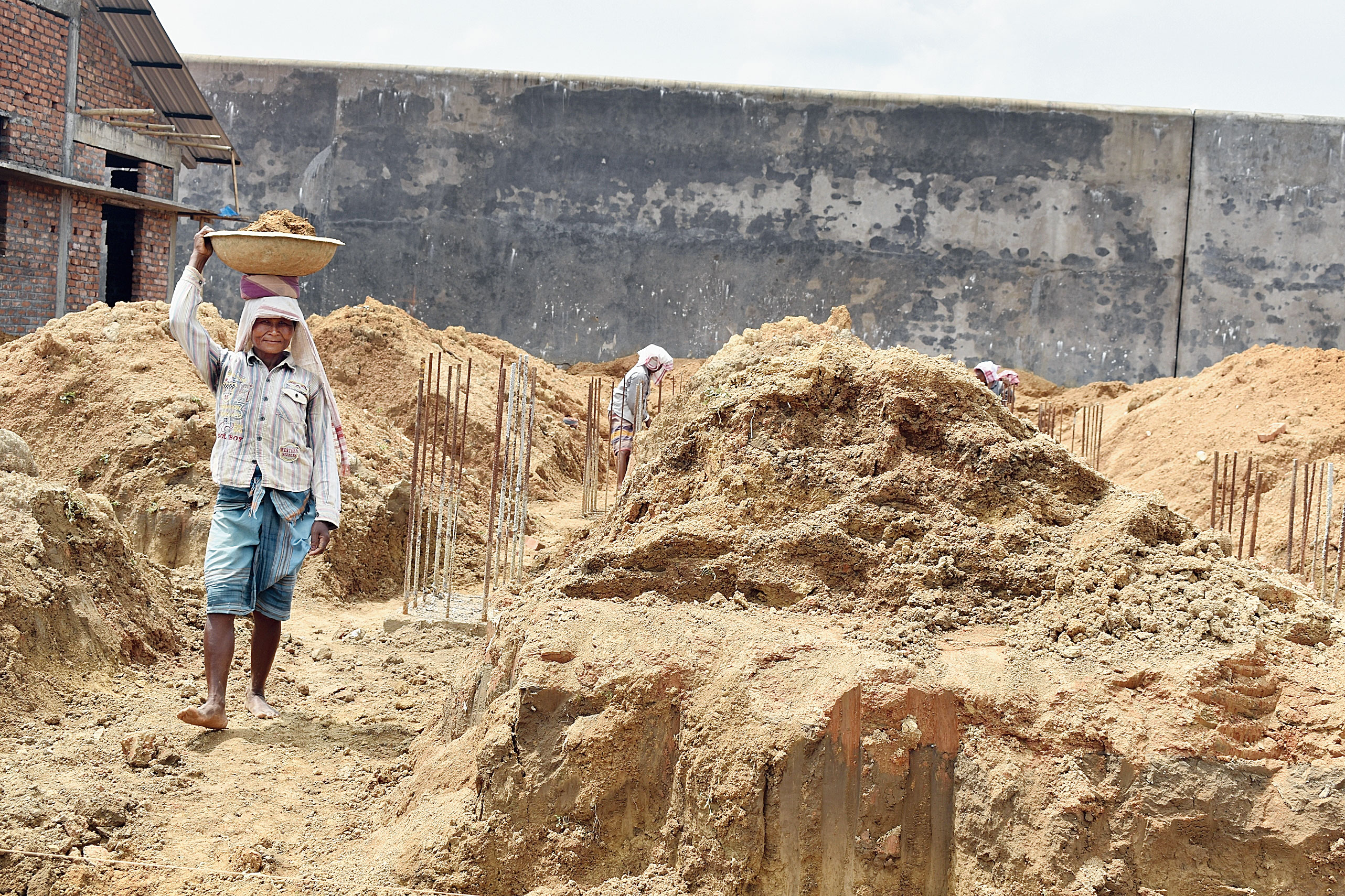 A labourer works at the camp in Matia in Goalpara.