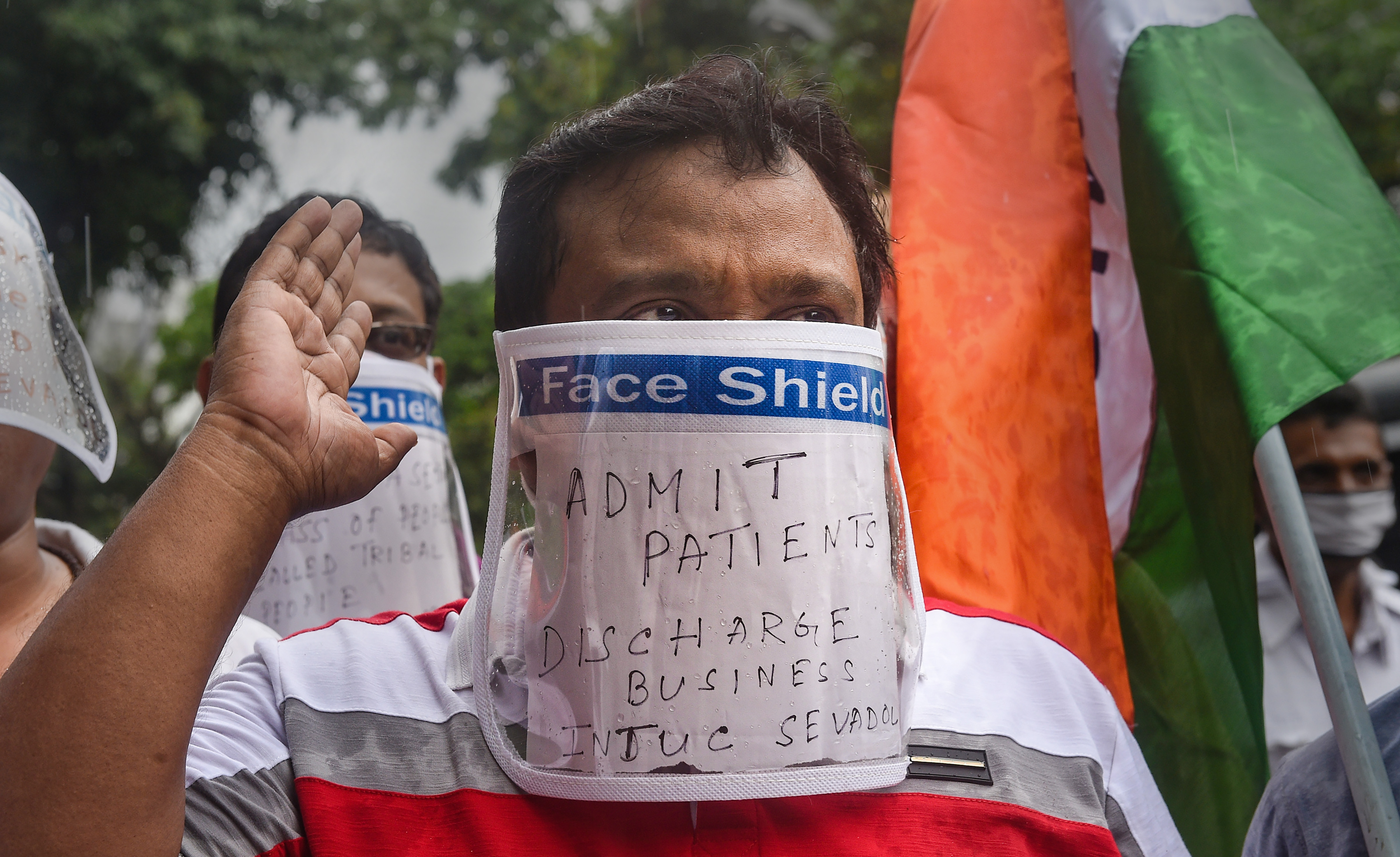 An activist wearing a face shield protests against alleged inadequacy of Calcutta Medical College Hospital in admitting Covid-19 patients, during the ongoing nationwide lockdown, in Kolkata, Tuesday, June 16, 2020.