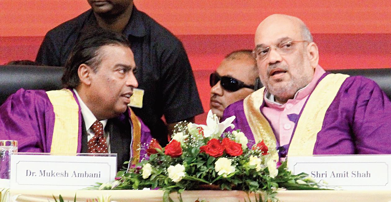 Mukesh Ambani and Amit Shah at the convocation in Gandhinagar on Thursday.