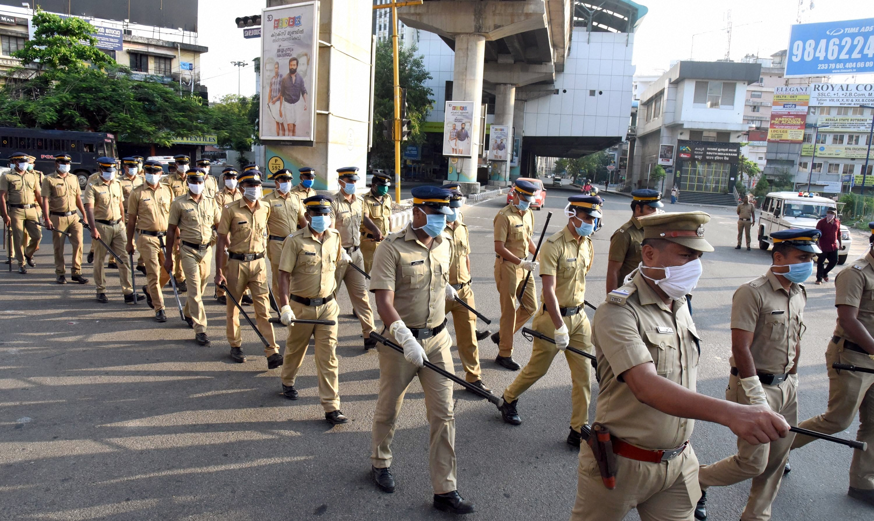 Police personnel conduct a march to enforce the Covid-19 lockdown strictly, in Kochi, Monday, April 20, 2020.
