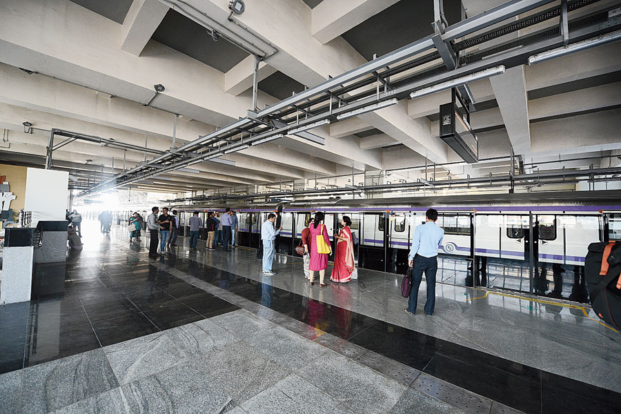 Commuters wait for a train at Salt Lake Sector V Station on Friday.