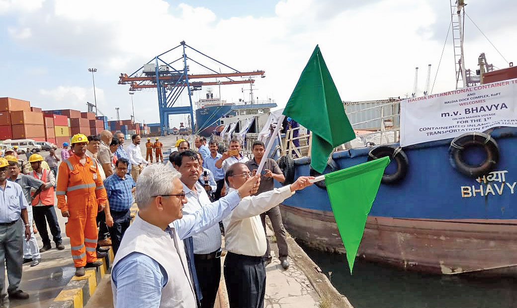 Haldia port officials flag off the barge with 52 containers on Tuesday.