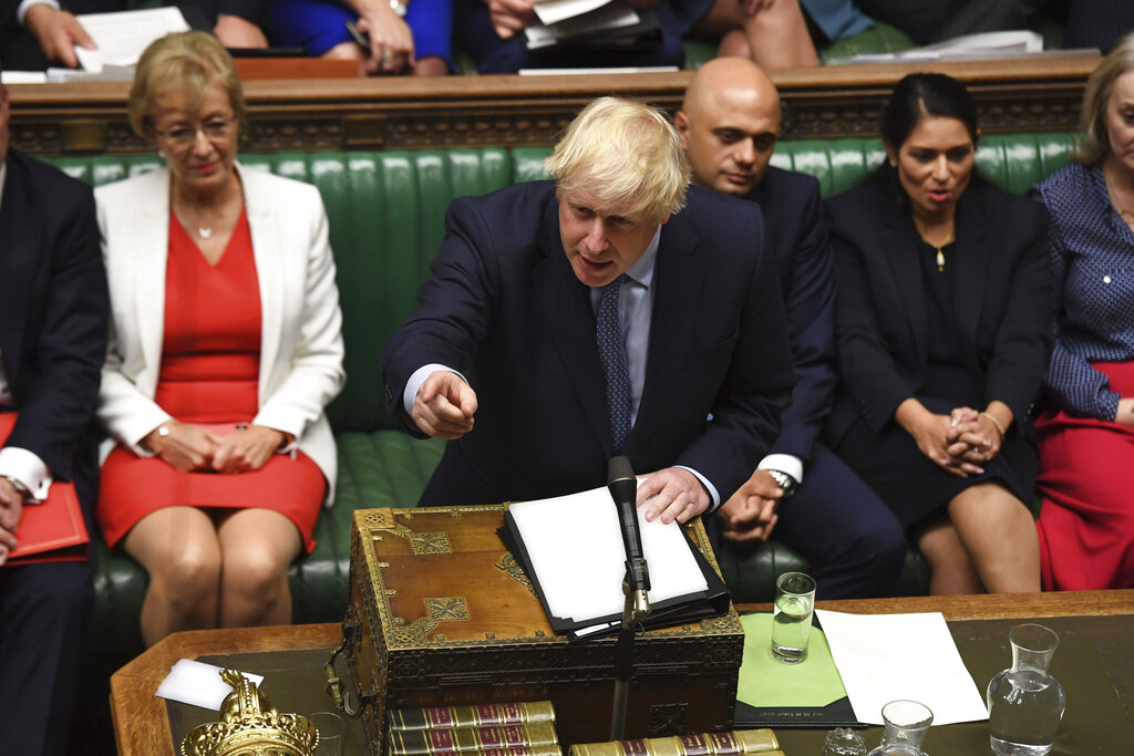 In this handout photo provided by the House of Commons, Britain's Prime Minister Boris Johnson speaks in Parliament in London, Wednesday, September 25, 2019.
