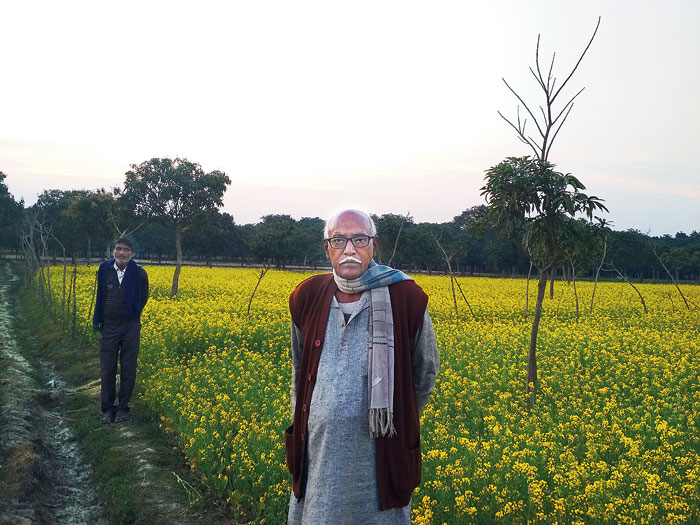 Grounded: Kedaranath Mondal in his mustard field in Kadirpur