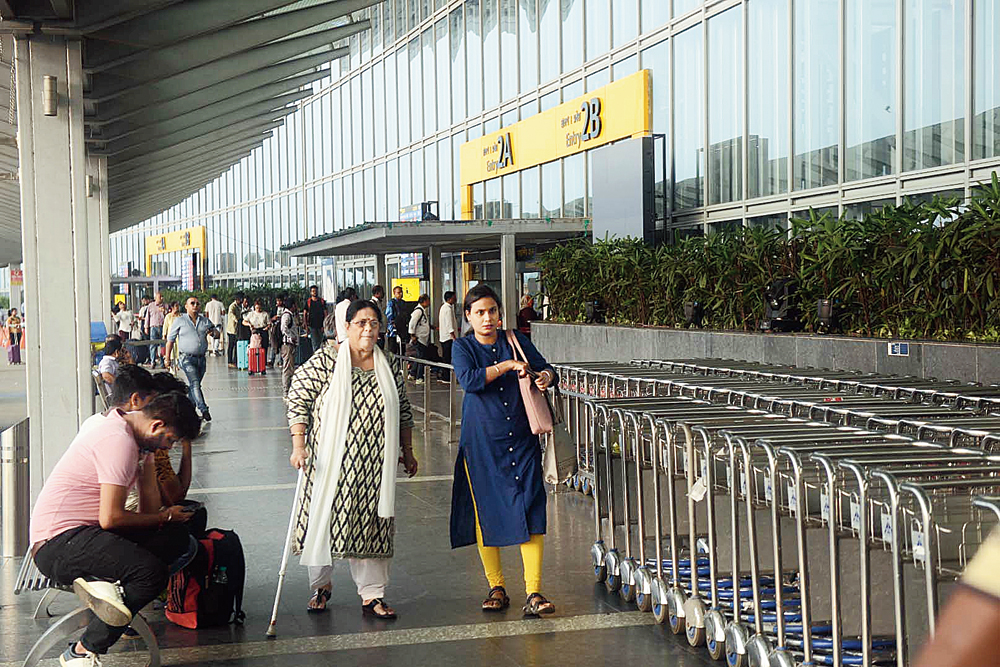 Deepanjali Ghosh (with walking stick) walks from Gate No. 2A of the airport to Gate No. 3C, at least 150m away, on Monday