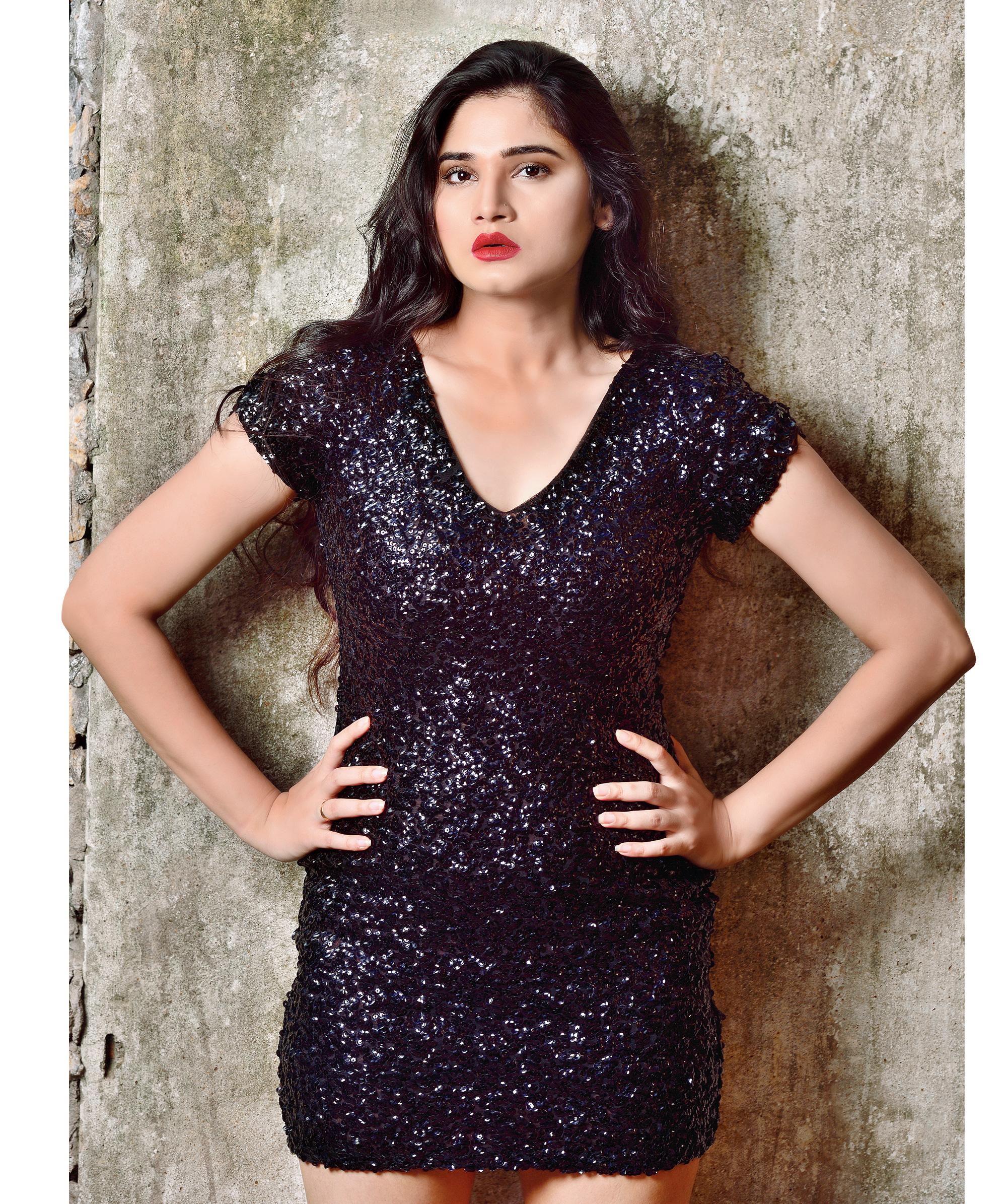 Model Bazla Reyaz in metallic black short dress