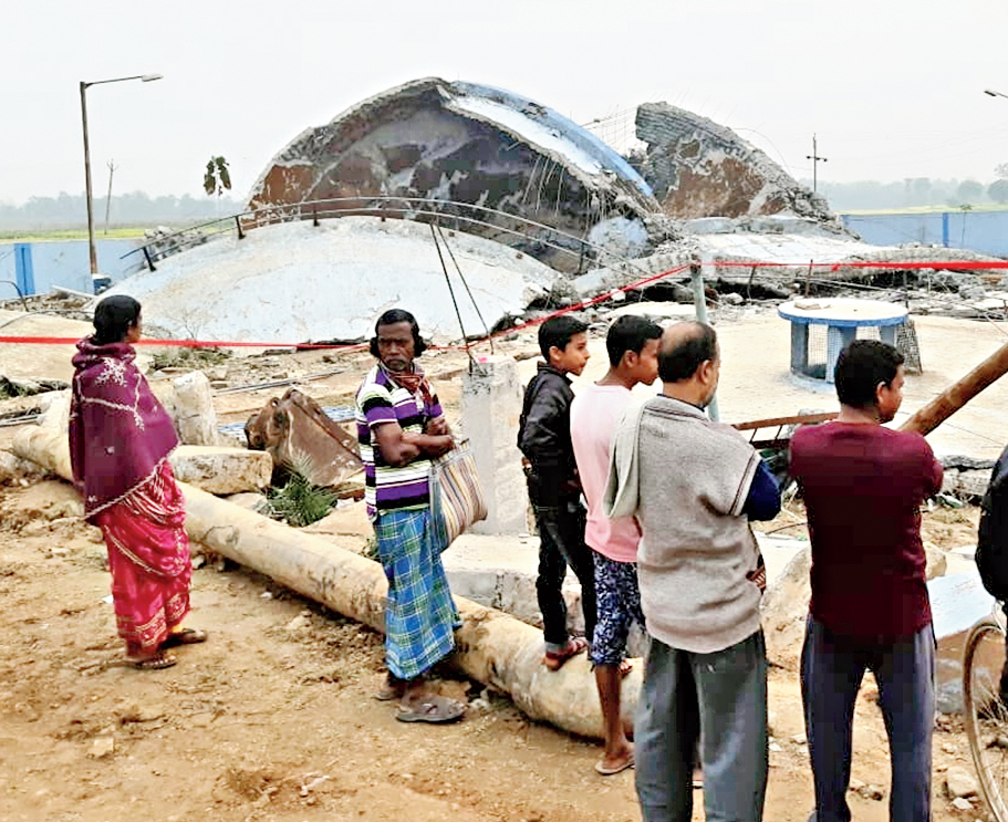 Villagers near the collapsed water reservoir on Thursday.