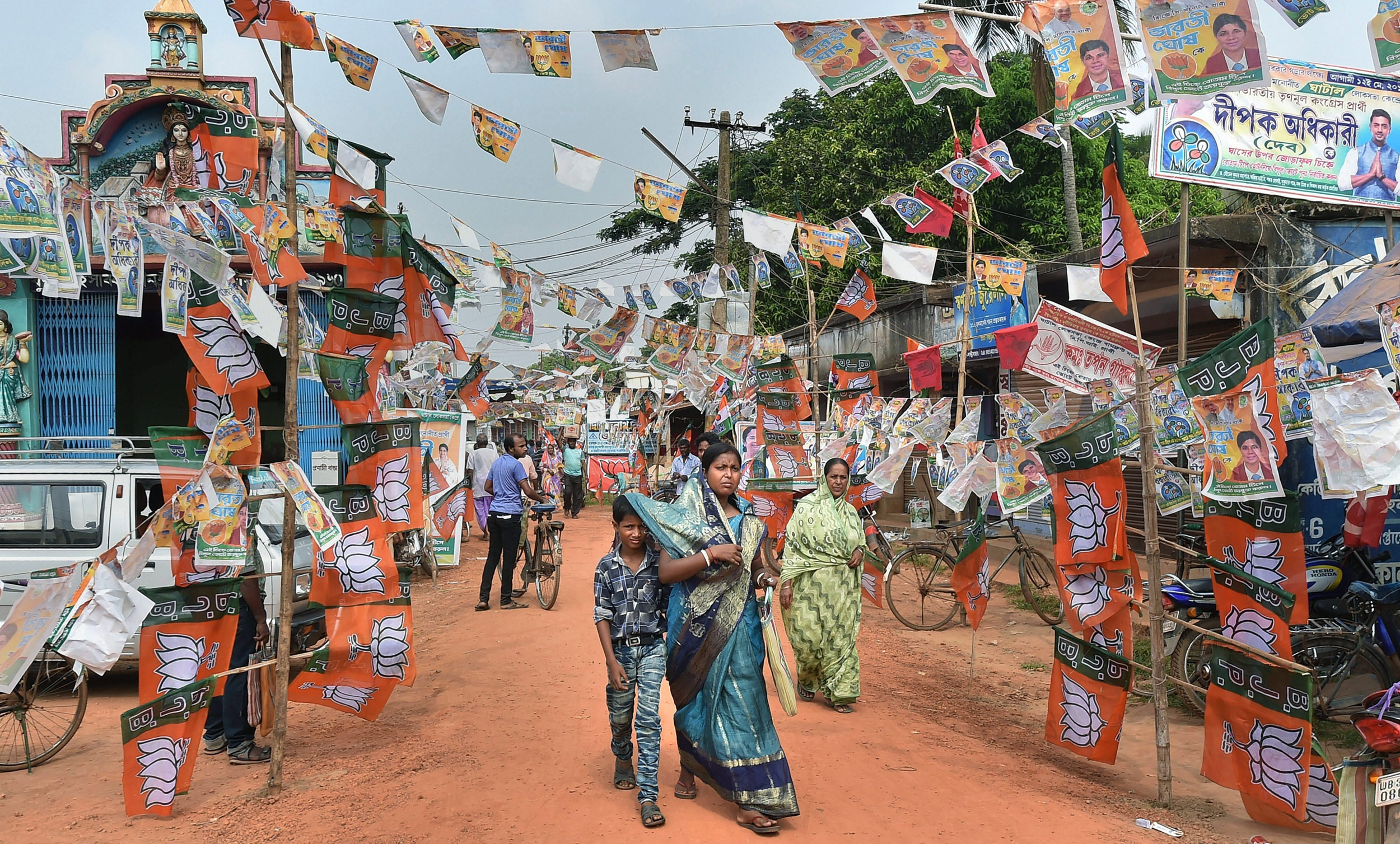 Flags and banners of political parties near a polling station during the sixth phase of the Lok Sabha polls, in West Midnapore, West Bengal, on May 12, 2019. The health of the democracy has seldom been a foremost concern for those who are responsible for its flowering.