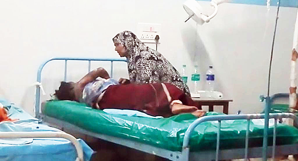 The injured girl with a relative at Malda Medical College and Hospital on Thursday