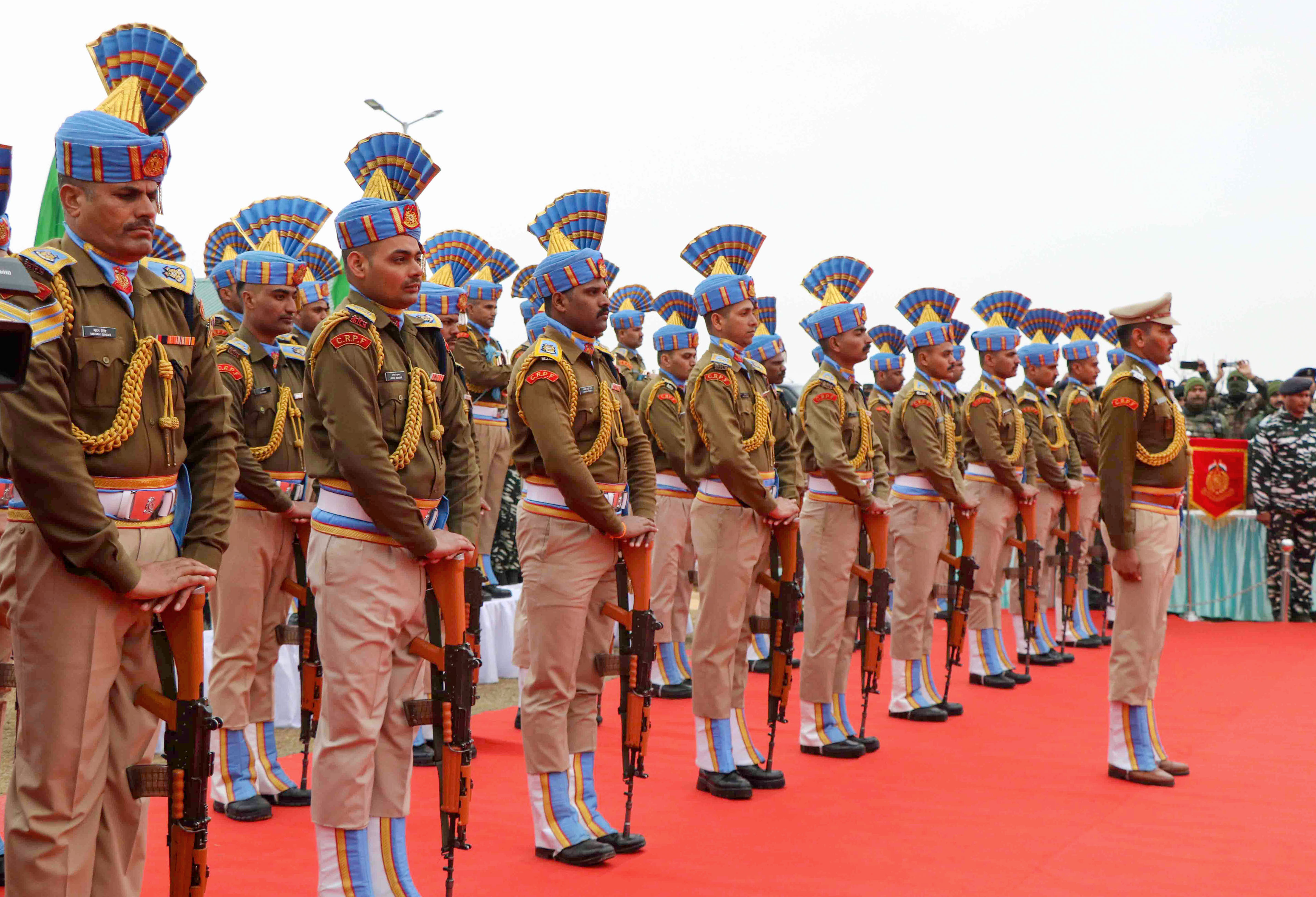CRPF personnel pay tribute at a memorial to the 40 CRPF jawans at Letapora of Pulwama District of South Kashmir on Friday