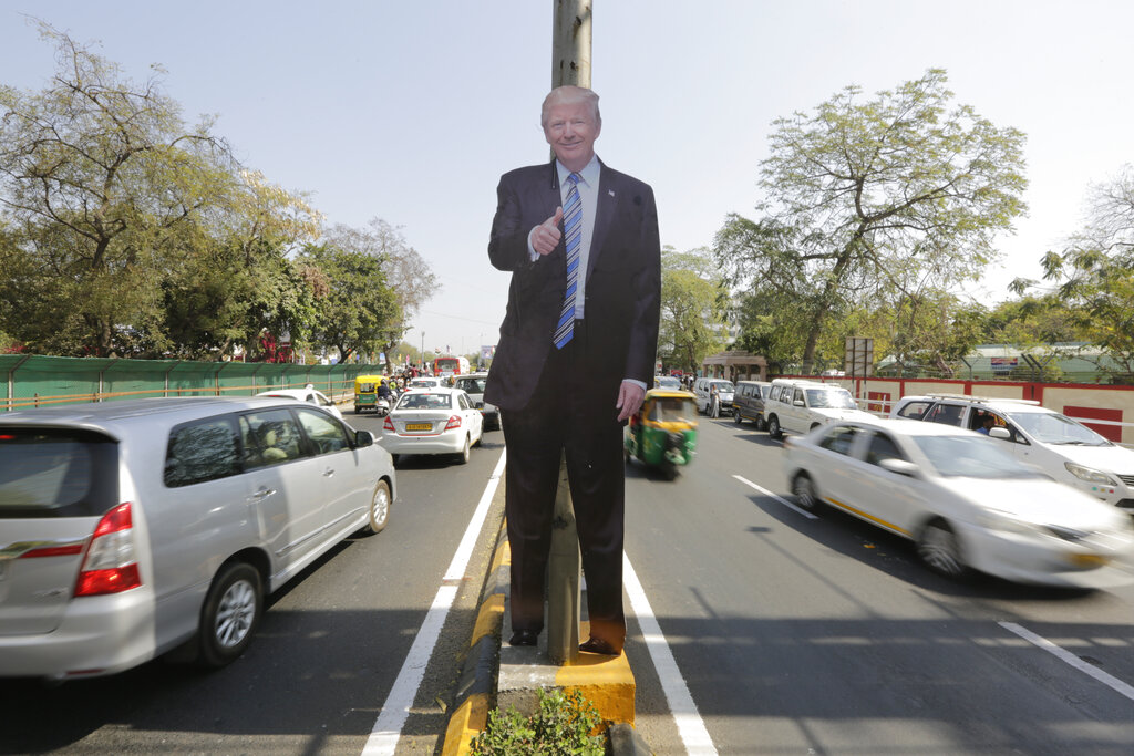 A life size cut-out of U.S. president Donald Trump stands on a road divider, ahead of his visit in Ahmedabad, on Saturday