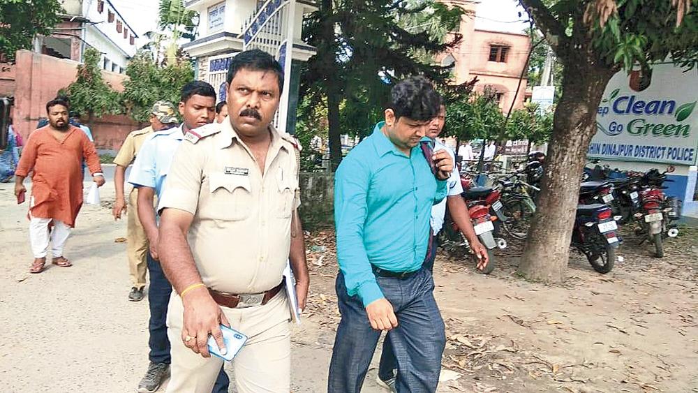 Land registry official Indrajit Dan after his arrest in South Dinajpur