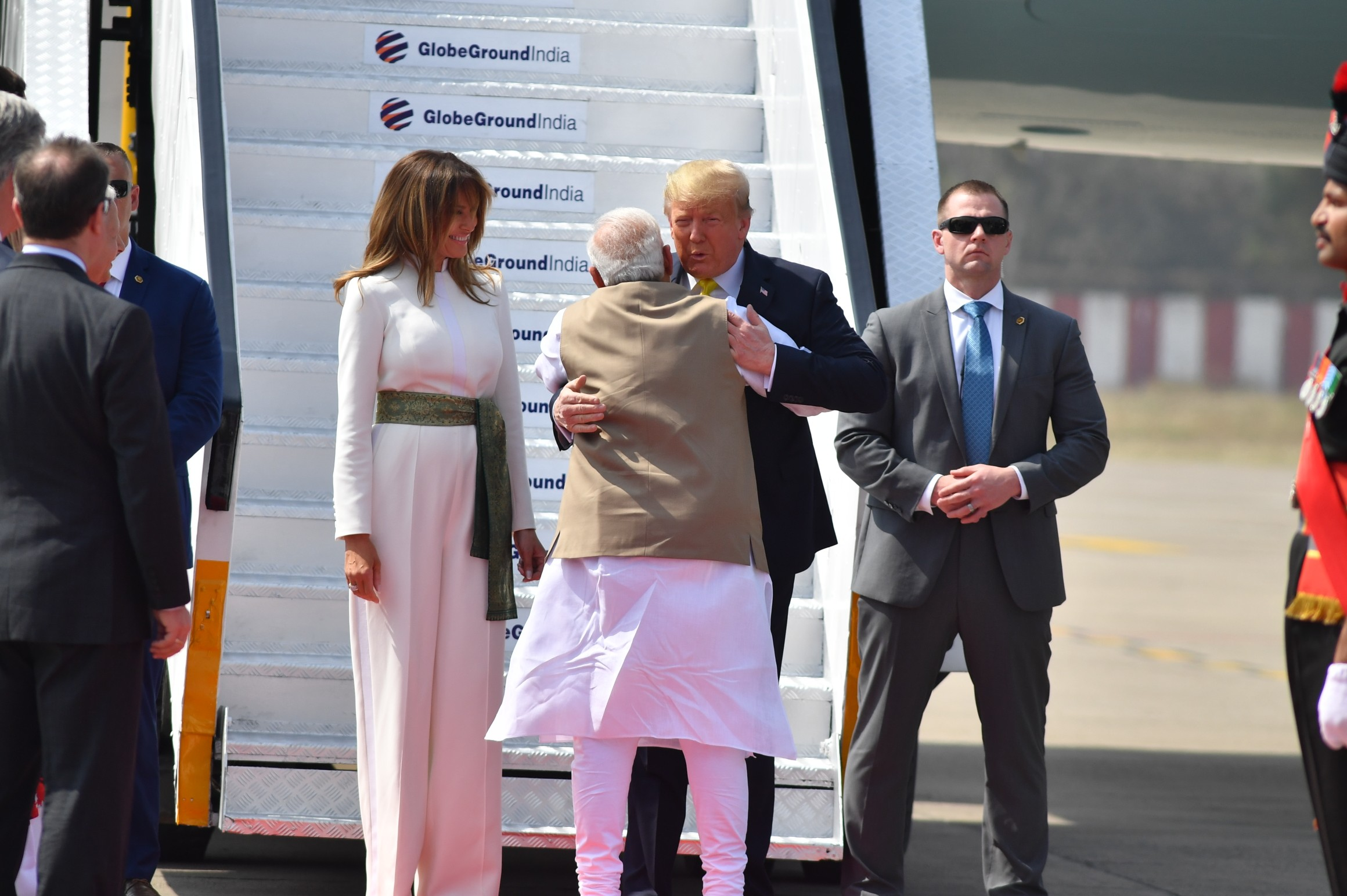 Prime Minister Narendra Modi greets US President Donald Trump as his wife Melania Trump looks on, upon their arrival at the Sardar Vallabhbhai Patel International Airport in Ahmedabad Monday, February 24, 2020