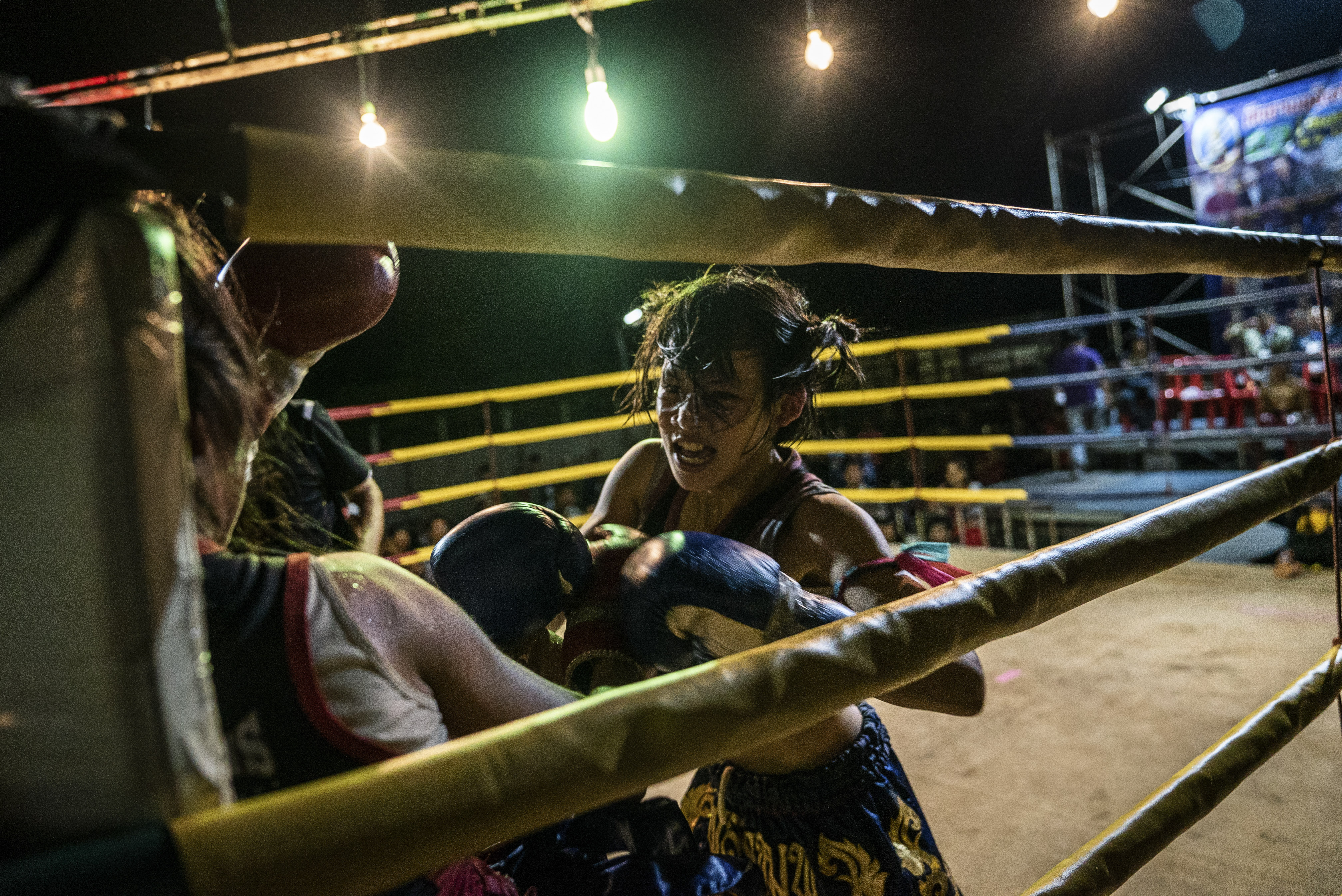 Supattra Inthirat, 12, known as Pancake, during a fight at a small local fighting stage in That Phanom, Thailand.