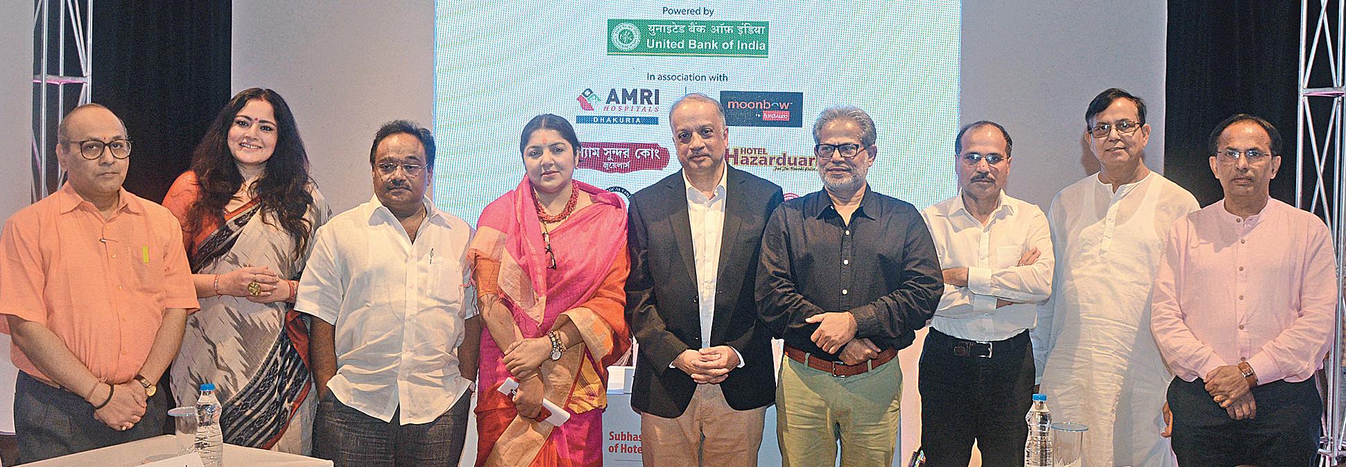 (From left) BJP leader Sarup Prasad Ghosh, Agnimitra Paul, former BJP MLA and party spokesperson Samik Bhattacharya, BJP MP Locket Chatterjee, cardiac surgeon and moderator of the debate Kunal Sarkar, Subodh Sarkar, Adhir Ranjan Chowdhury, Mohammad Salim, and Abhijit Chowdhury at Desh Bitarko 2019.