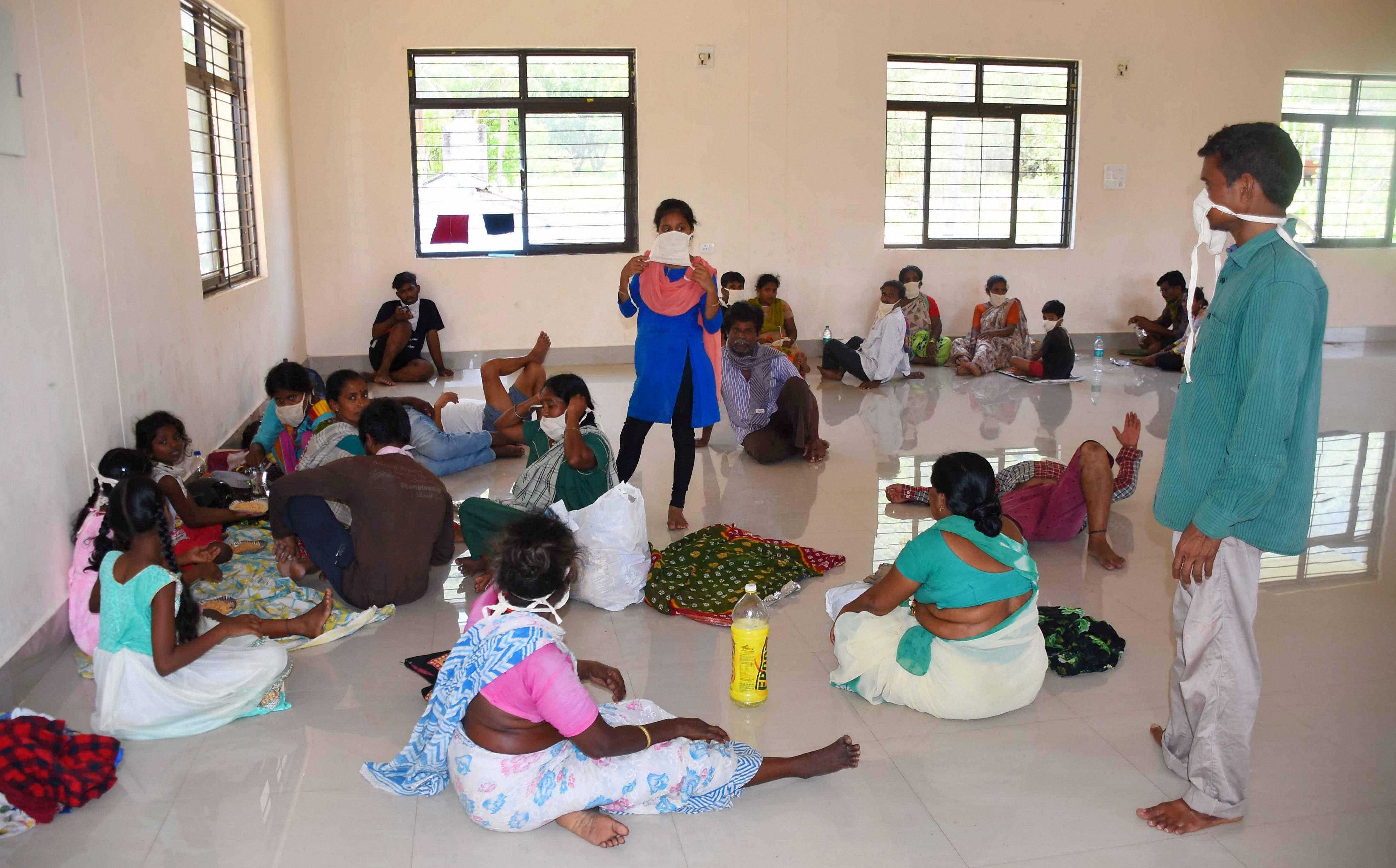 People at a shelter at RR Venkatapuram village in Visakhapatnam on Friday