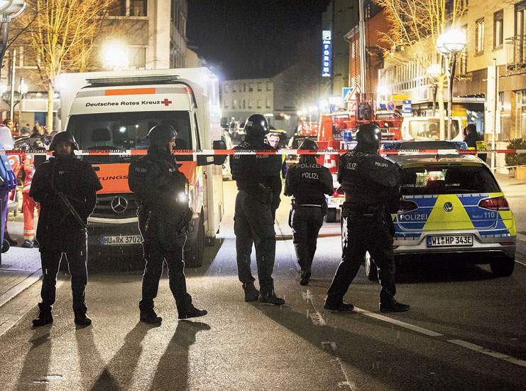 Armed policemen on guard after the shooting in Hanau, Germany, on Wednesday evening
