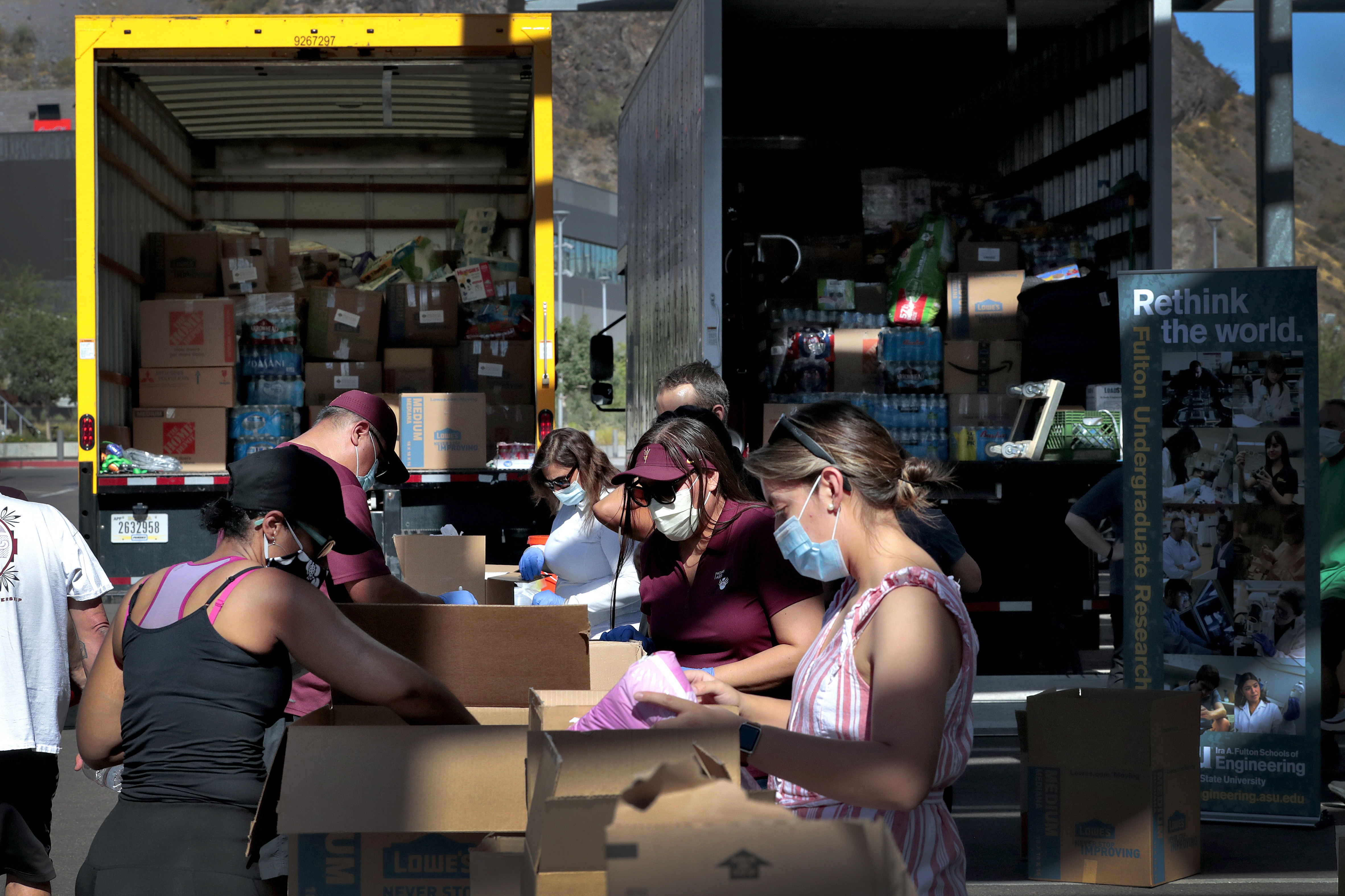 Volunteers prepare donations for delivery to those affected by Covid-19 on tribal lands on June 25 in Tempe, Arizona
