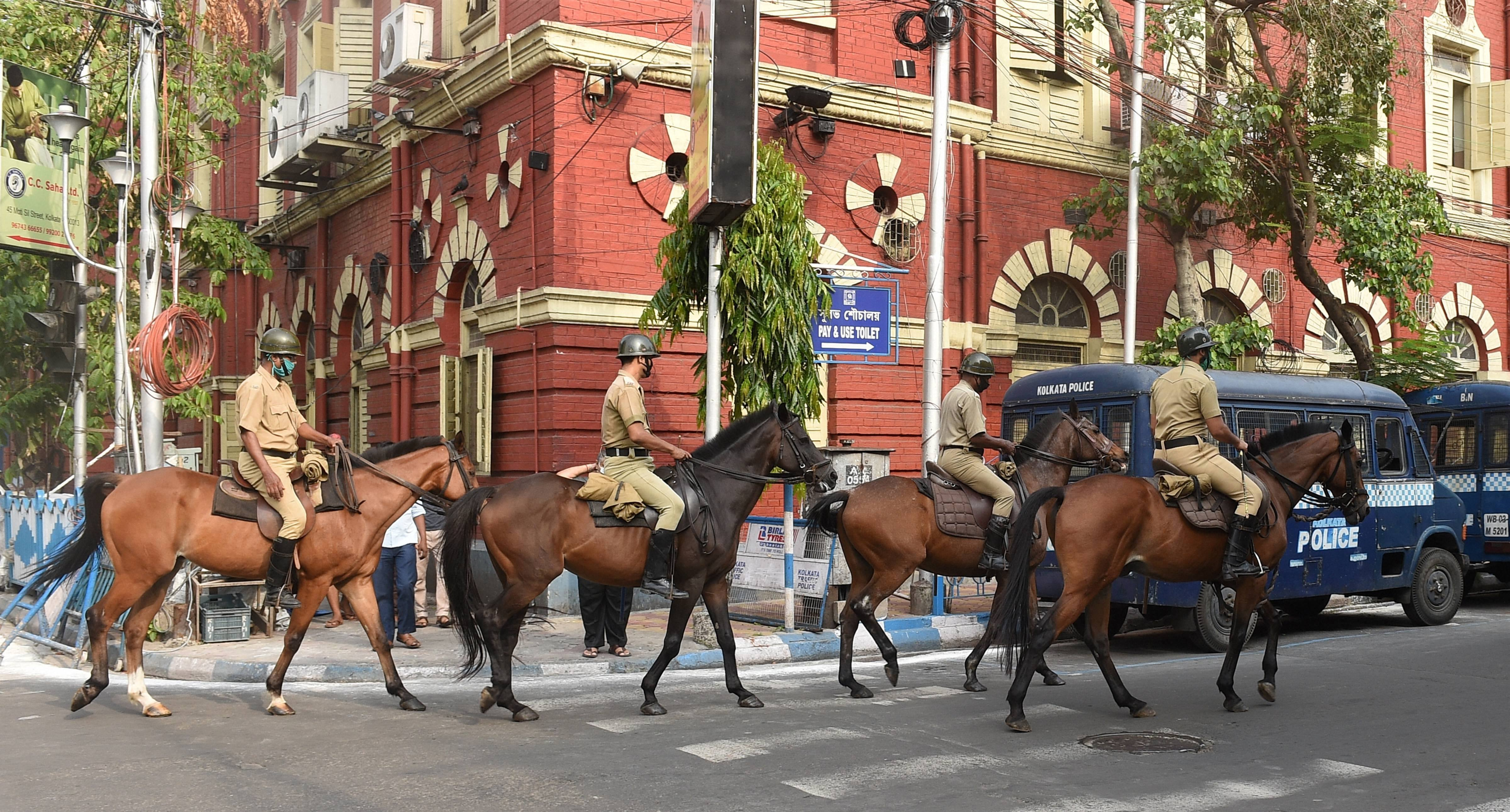 Mounted police personnel patrol on a road during the fifth phase of Covid-19 lockdown, in Calcutta, Friday, June 5, 2020