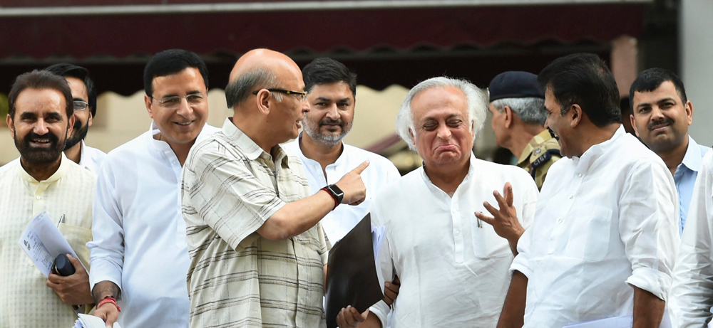 Congress leader Abhishek Manu Singhvi, Jairam Ramesh and Randeep Surjewala and party senior leaders leave after a meeting with Election Commission officials at Nirvachan Sadan, in New Delhi, Friday, April 12, 2019.
