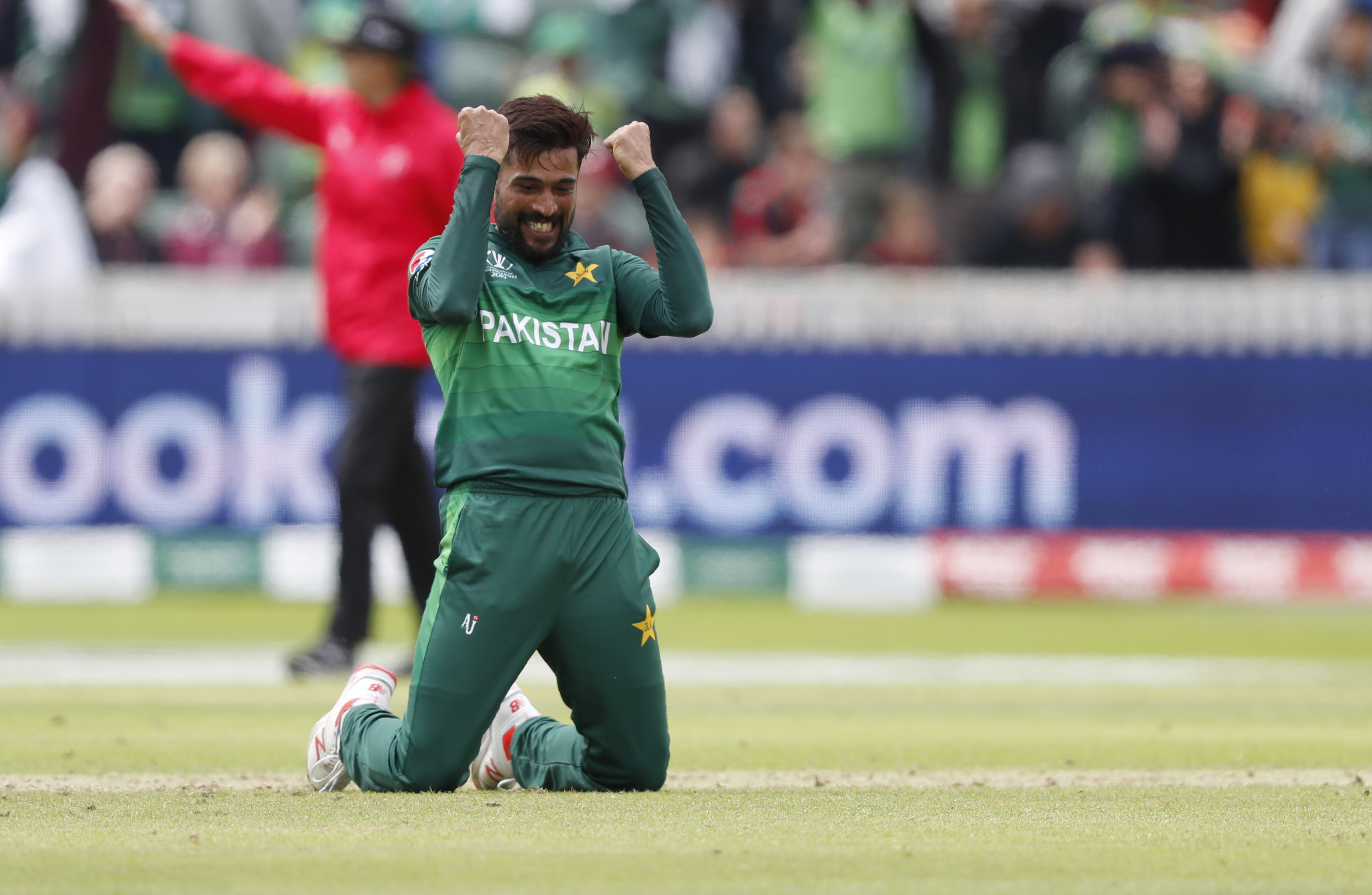 Pakistan's Mohammad Amir celebrates after taking the wicket of Australia's Mitchell Starc at the County Ground in Taunton on June 12.