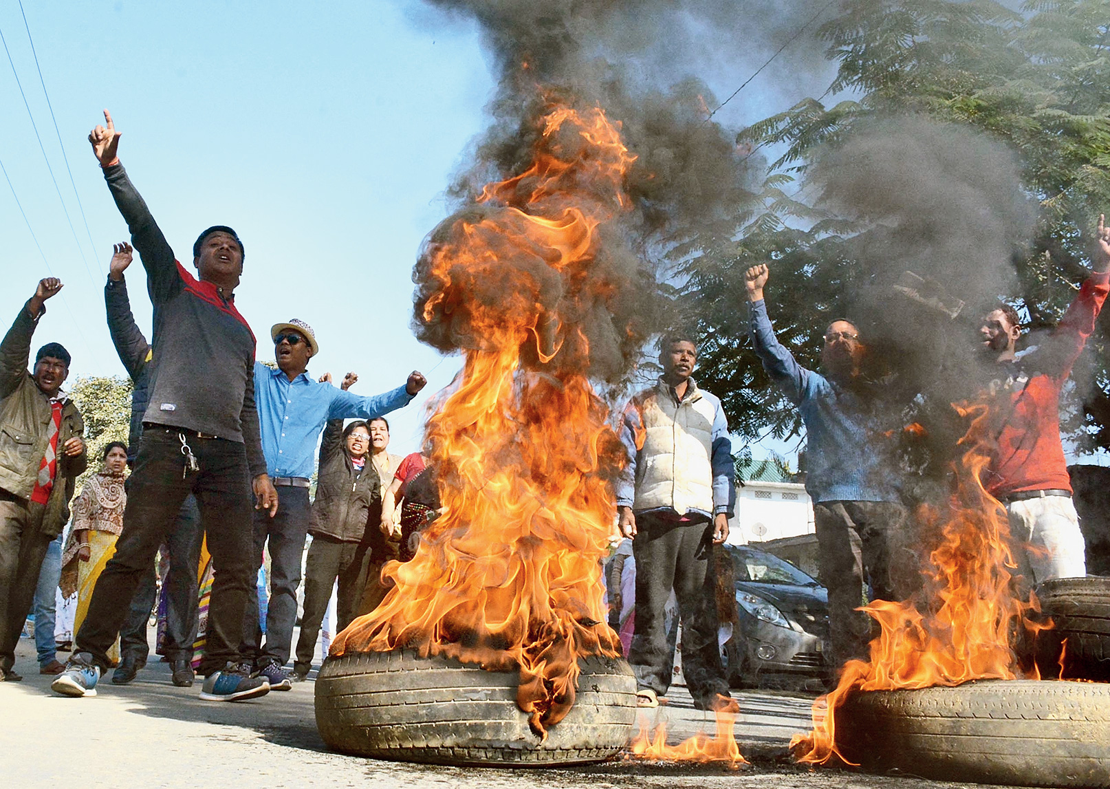 Bandh supporters burn tyres in front of chief minister Sarbananda Sonowal's residence in Dibrugarh on Tuesday to protest against the citizenship bill.