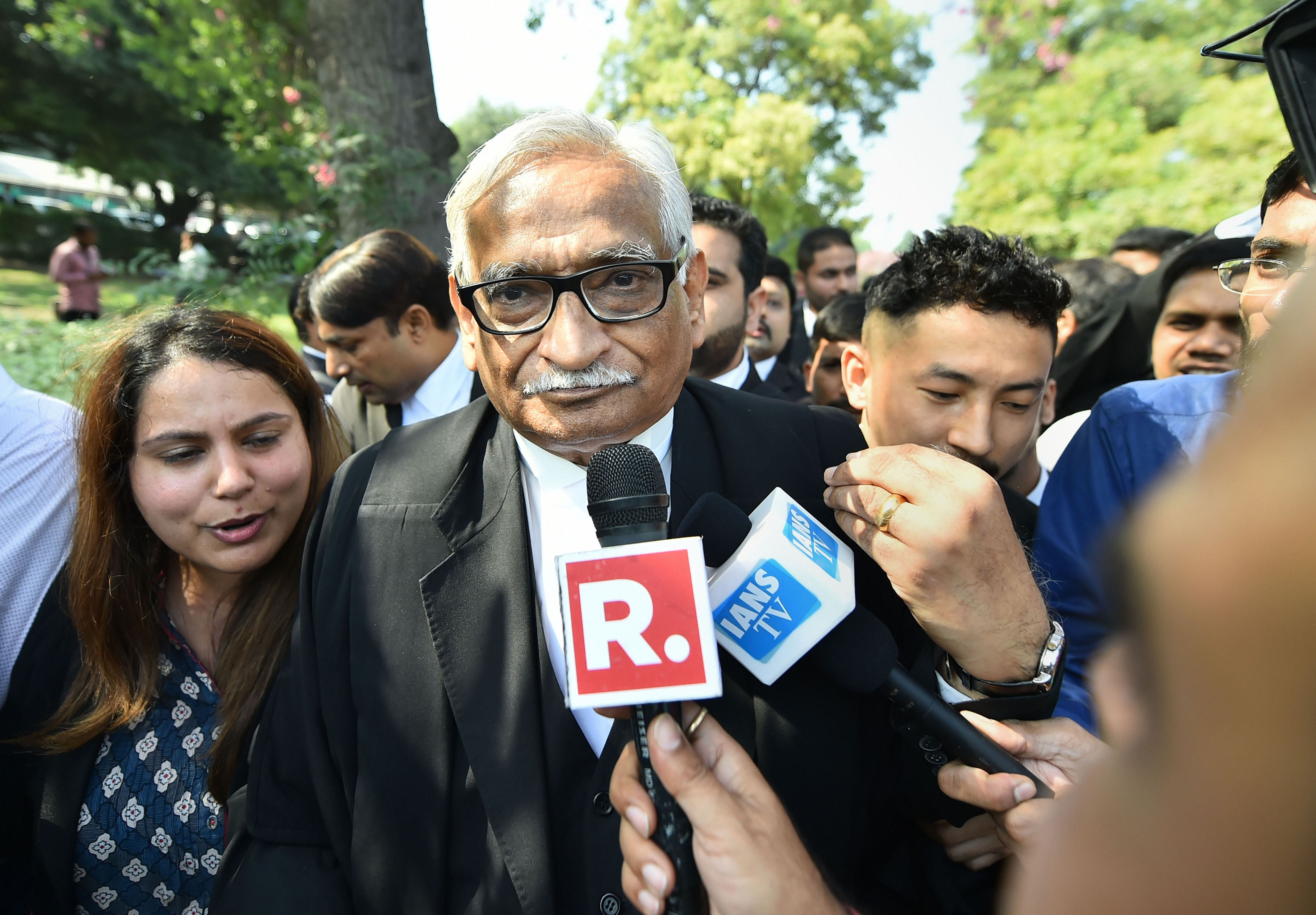 In this Saturday, November 9, 2019, file photo taken in New Delhi, senior advocate Rajeev Dhavan, representing the Muslim parties, comes out of the court after the Supreme Court verdict on the Ayodhya case, .
