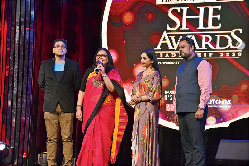 Lopamudra Mitra receives her award from Anupam Roy, June and Manish Iyer, region head, West Bengal and Sikkim, Pernod Ricard India.