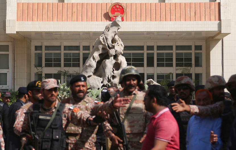 Pakistani troops move in the compound of the Chinese consulate in Karachi on Friday.