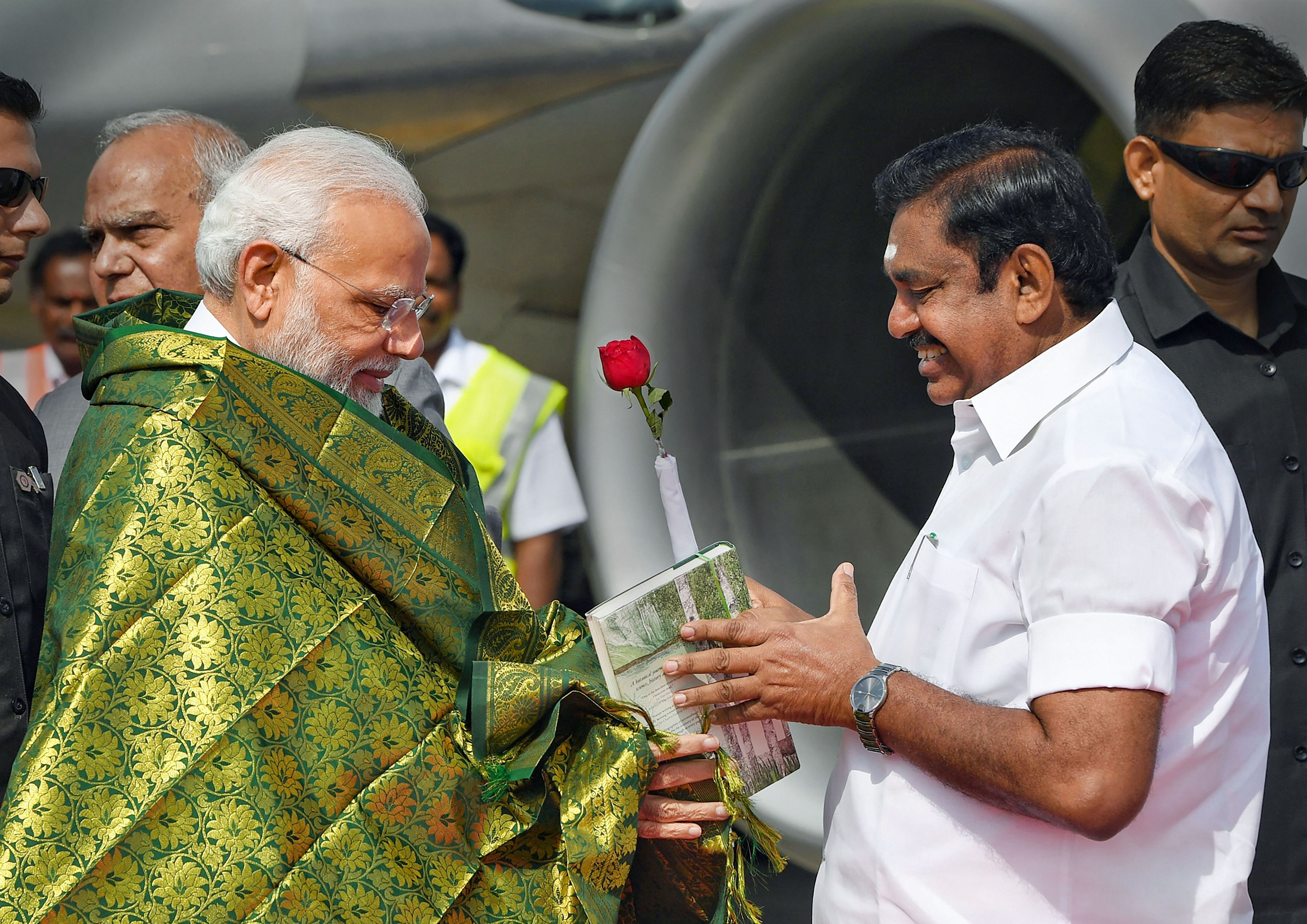 Prime Minister Narendra Modi being welcomed by Tamil Nadu chief minister Edappadi K Palaniswami on his arrival in Chennai on Monday