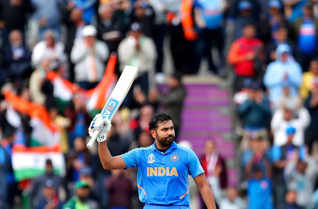 All is well: Rohit Sharma raises his bat to celebrate after scoring a century during the match against South Africa on Wednesday