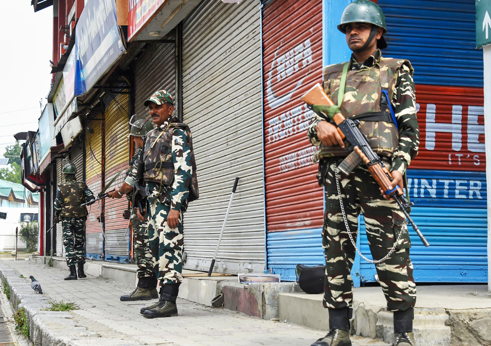 Security personnel stand guard during restrictions to maintain law and order in Srinagar, Friday, August 30, 2019.